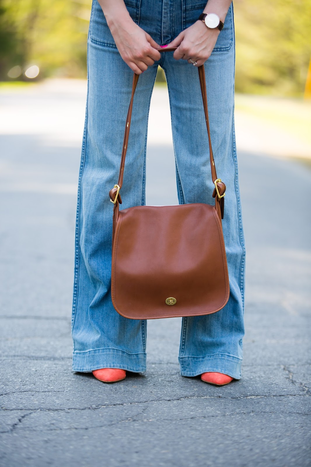 flare denim and coach stewardess bag