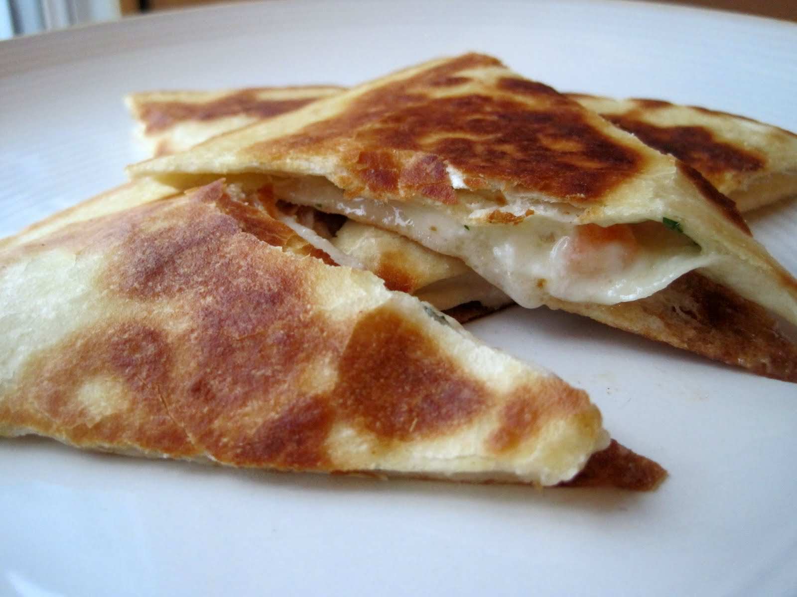 Top with another tortilla and add either butter or oil to a large ...