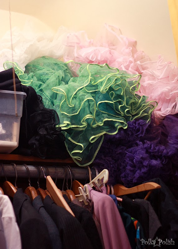 colorful petticoats falling off a shelf in an over-stuffed closet.