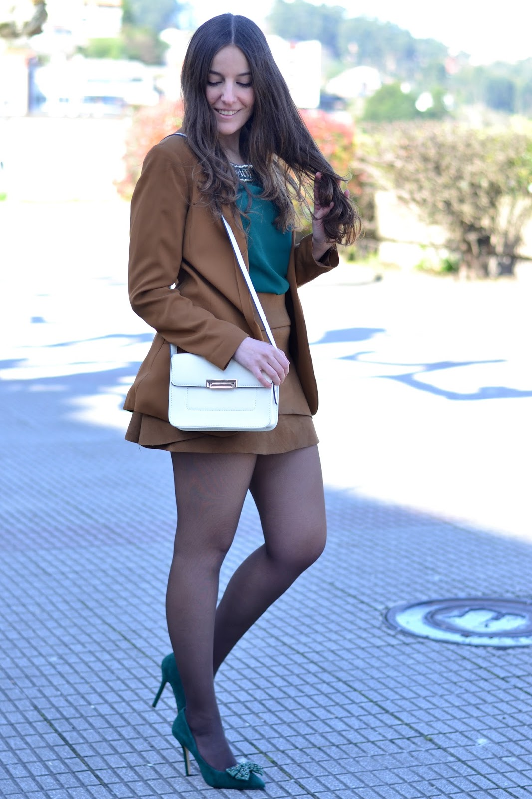 camel blazer, green shirt, white bag