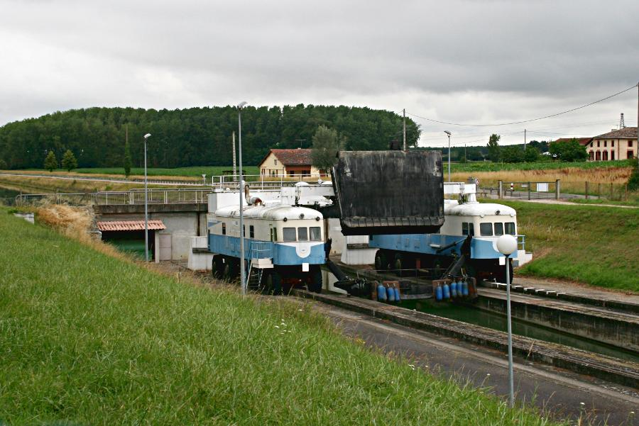 two locomotives on either side of channel