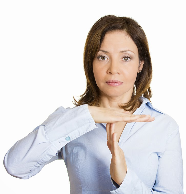 "image of a woman giving the sign for ""time out"""