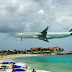 Low Fying Airplane In Maho Beach