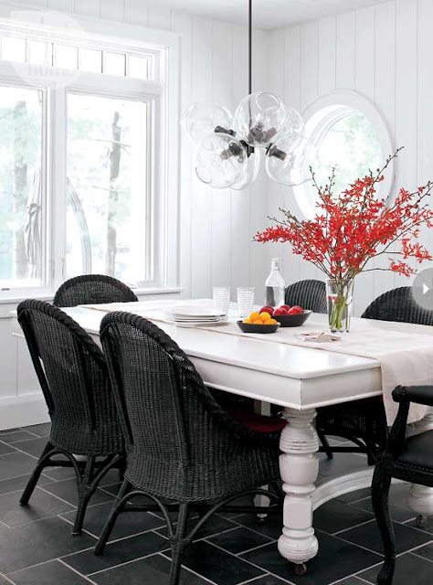 black wicker chairs turned leg wood dining table glass pendant light modern country dining room