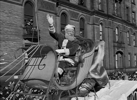 Kris Kringle riding in a sleigh in Miracle on 34th Street