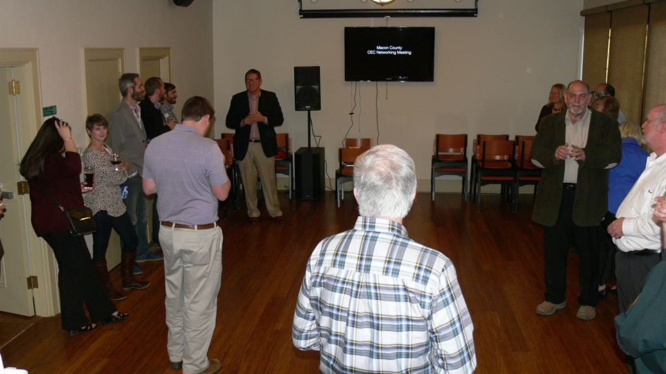 Local entrepreneurs gather to watch a promotional video about Macon County