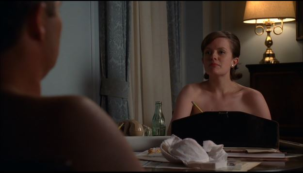 Peggy Olson and Stan Rizzo go over ideas in the nude