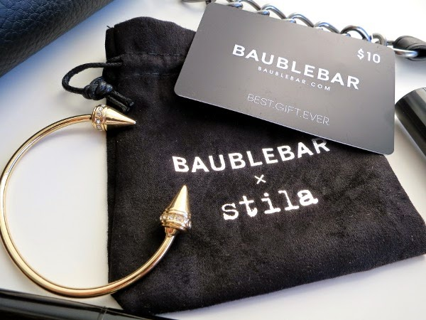 Stila x Bauble Bar limited edition holiday 2014 gift sets include a $10 Bauble Bar gift card and bracelet.