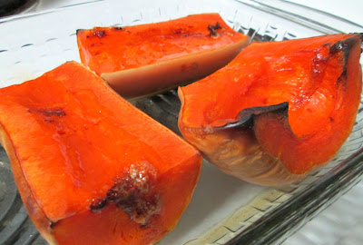 Halves of roasted butternut squash in baking pan