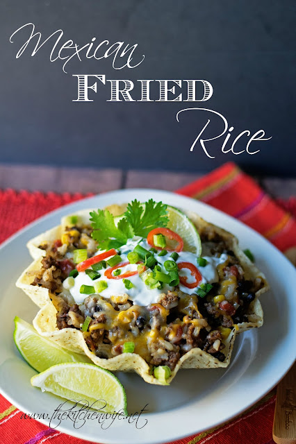 Finished Mexican fried rice, in a tortilla bowl, with toppings and the ...