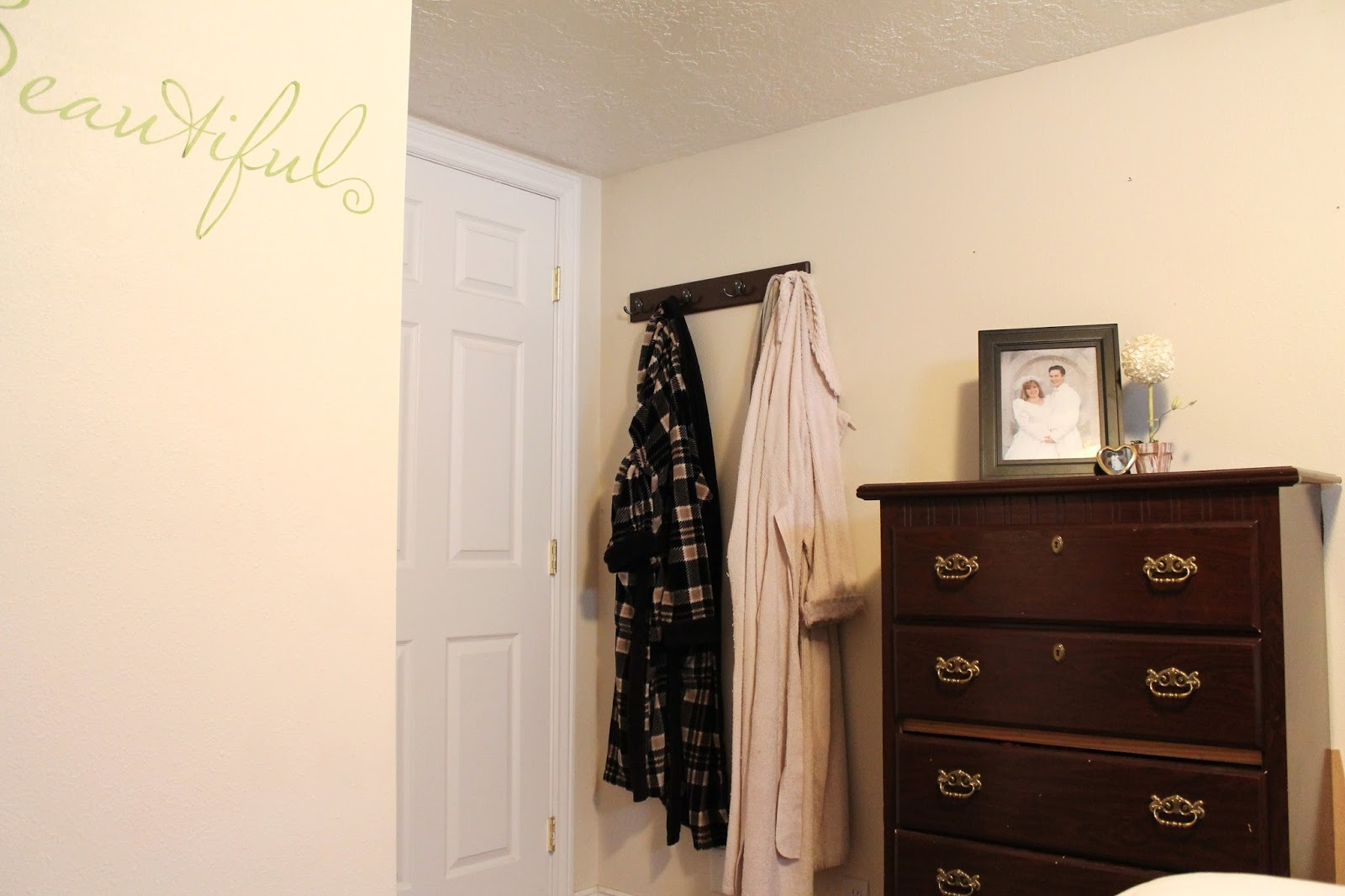 we re purposed some hooks and made a spot for robes behind the door