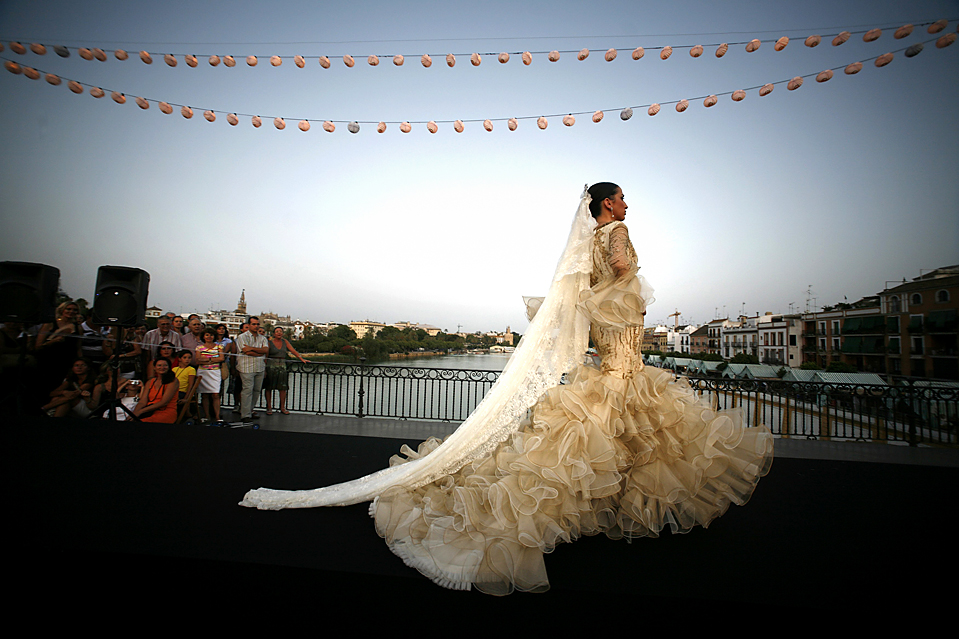 Mexican wedding wedding traditions around the world for Flamenco style wedding dress