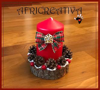 Candela natalizia su tronchetto