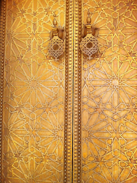 Gold door with inlayed designs in Morocco