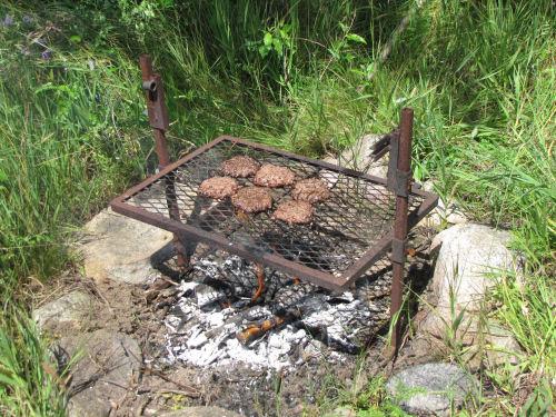 hamburgers on open fire