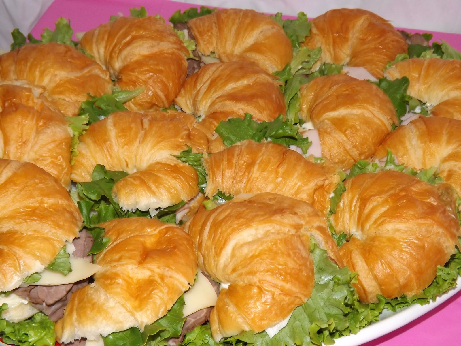 Yummy croissant sandwiches with turkey, roast beef, Swiss cheeses ...