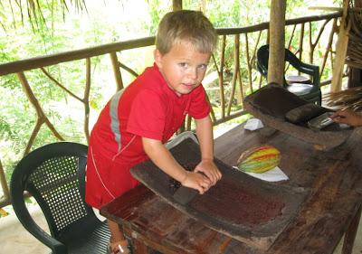 Grinding cocoa beans in Punta Gorda Belize - mckinley pritchard placencia
