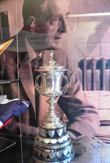 Silver trophy in case