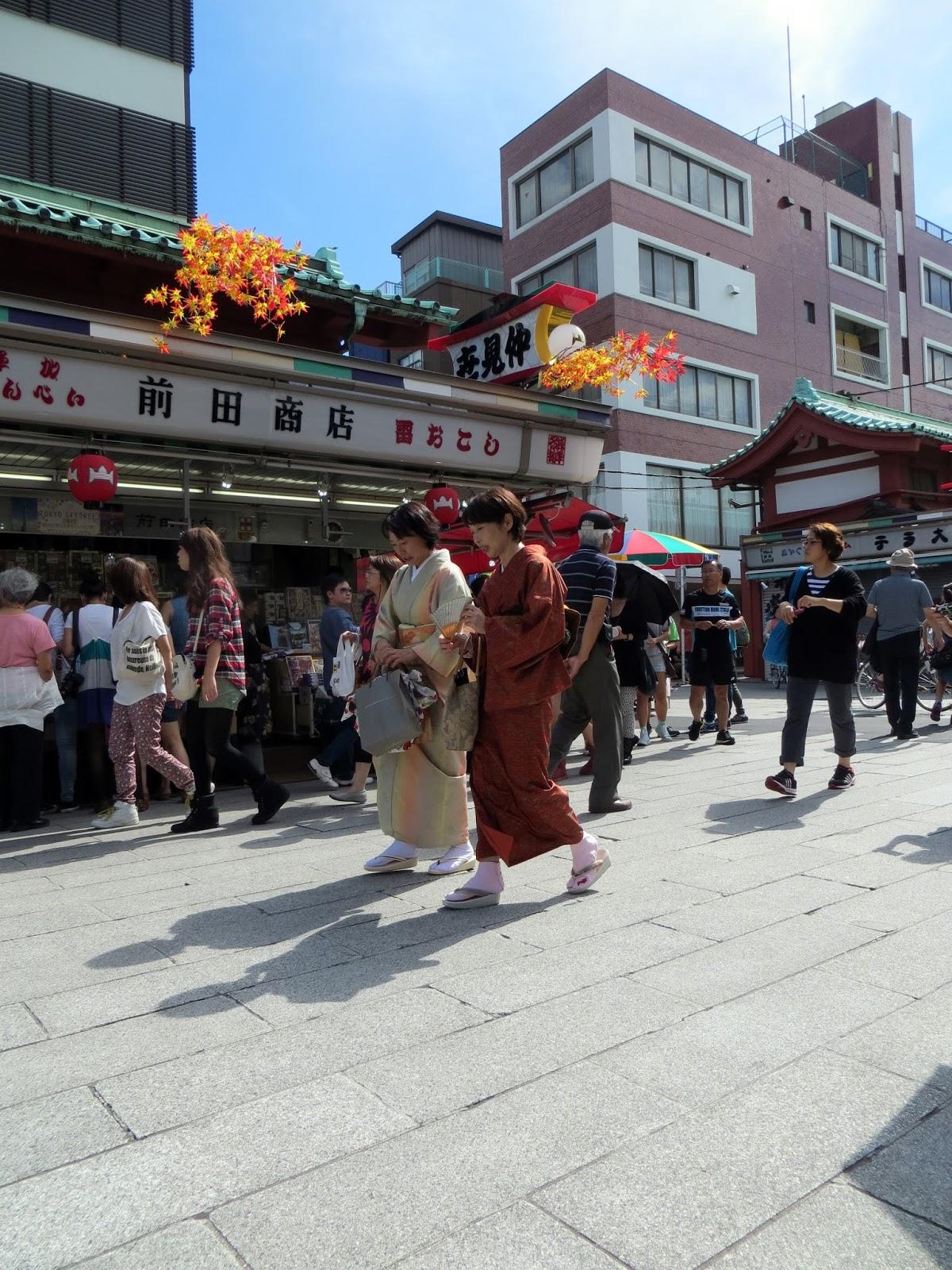 Women in Kimonos walk past a temple in Tokyo, must do tokyo