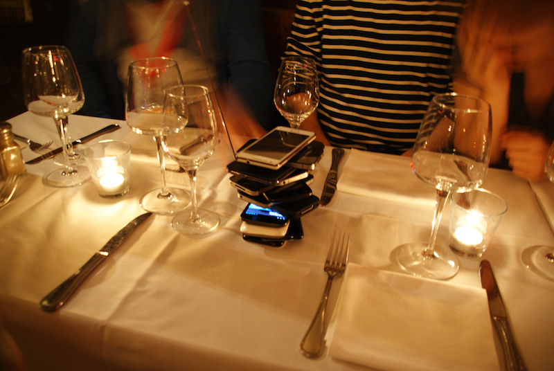 Bilderesultat for phone stack at dinner