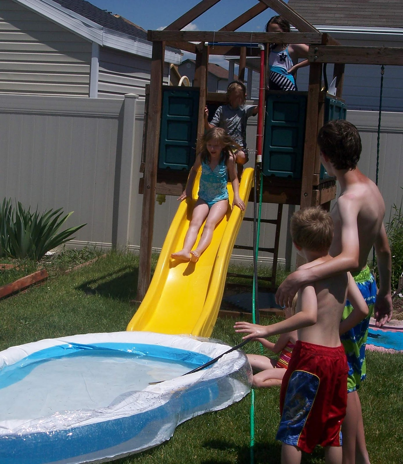 Backyard Waterslide come out when you're happy: how to turn your backyard slide into a