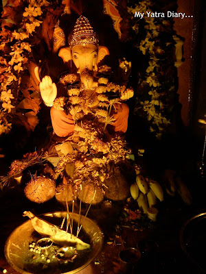 Ganpati pandal with flowers, garlands and coconuts decoration