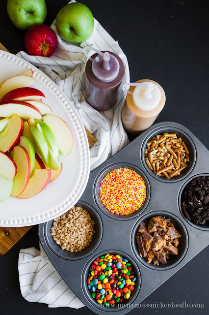 Caramel Apples are always so delicious, but make them a whole lot easier with this caramel apple nacho bar!  How cute and fun for a halloween party or fall festival!  |  My Name Is Snickerdoodle