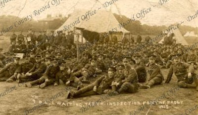 Soldiers of the 9th Battalion, The Durham Light Infantry, 'waiting teeth inspection for the front', 1915 (D/DLI 2/9/288)