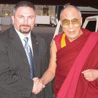 Supervisory Special Agent Darrin Whatley with the Dalai Lama