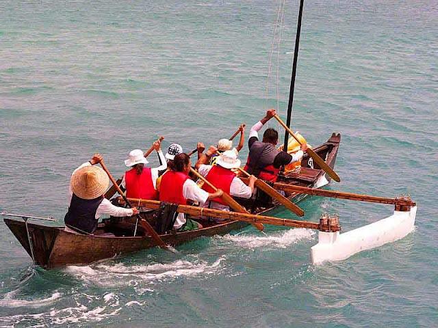 team paddling a sailing sabani boat