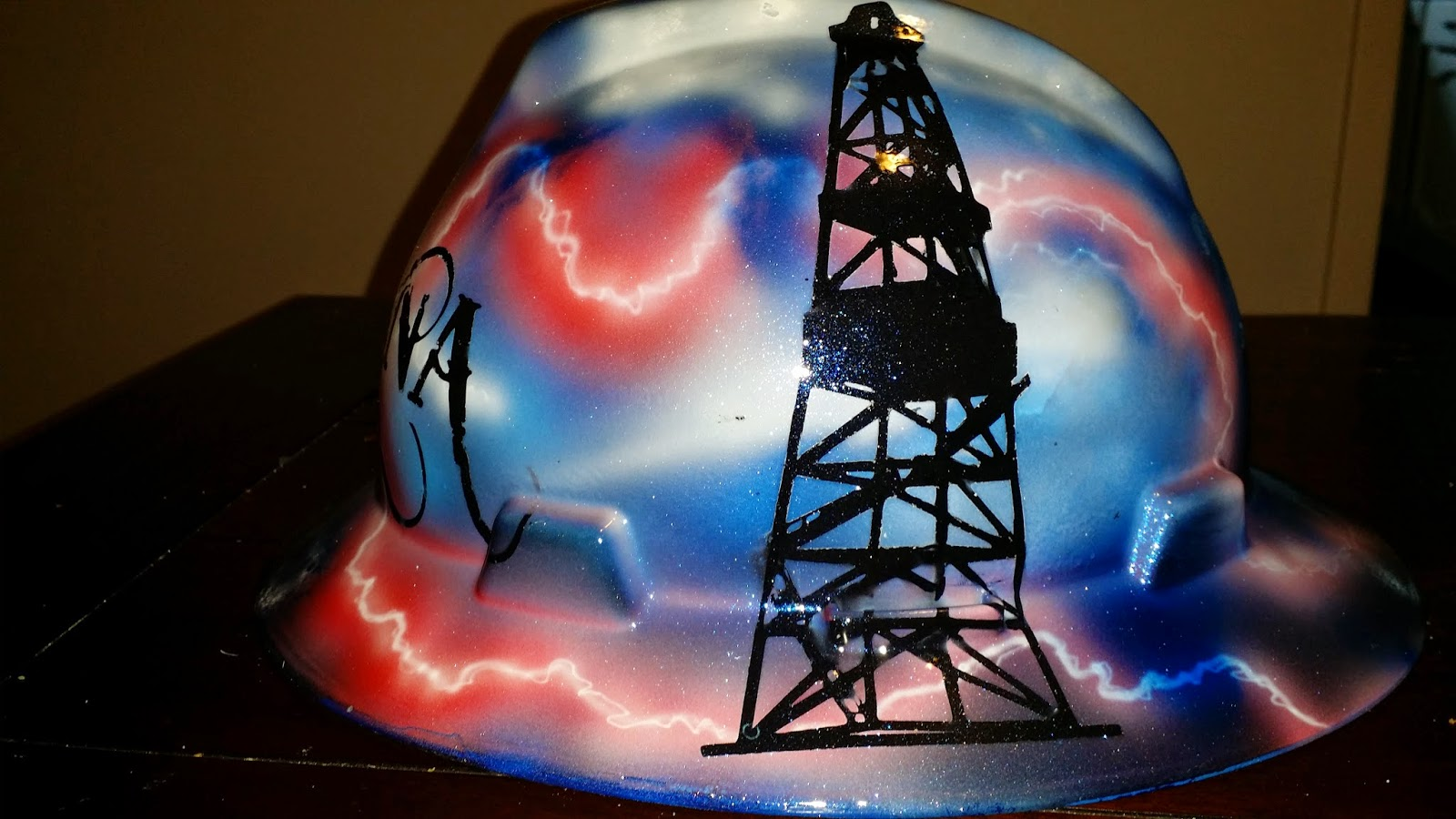 custom hard hat design with storms and derricks