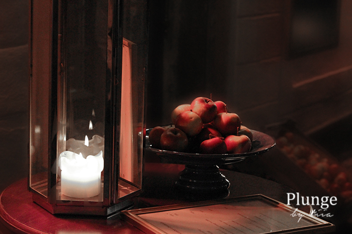 Candle light and apples