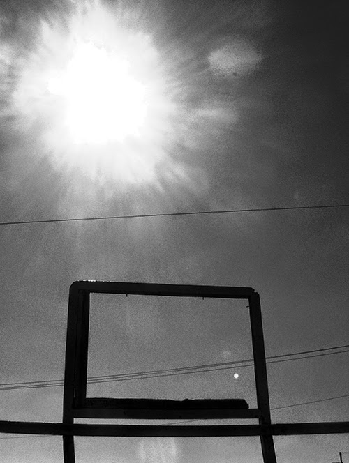 sun flare, urban photography, contemporary, black and white
