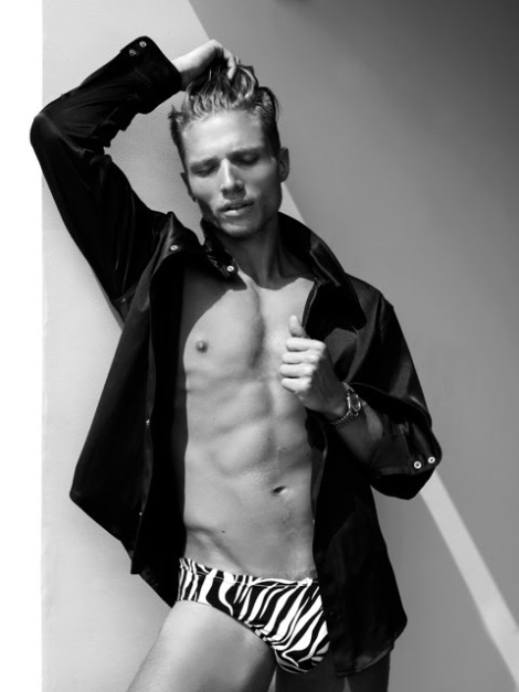 Jason Boyce wearing zebra print swimwear