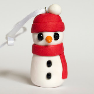 Red hat fimo snowman