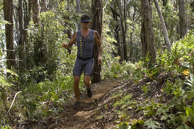 Lance Armstrong runs on the trail during the running portion of the Xterra World Championship triathlon in Kapalua, Hawaii, on October 23, 2011. Armstrong's win in a trail race last weekend has sparked discussion about doping in trail races