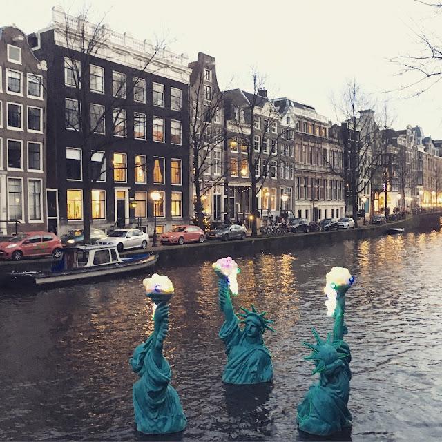 Sunken Statues of Liberty at Amsterdam Light Festival
