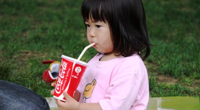child drinking coke