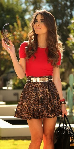 Red blouse, golden belt, cheetah skin skirt and hand bag
