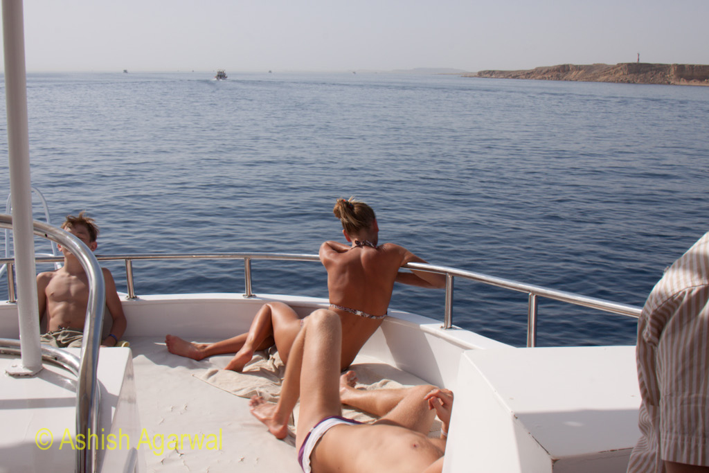 Tourists relaxing on the small yacht used to take tourists to the snorkeling and scuba diving