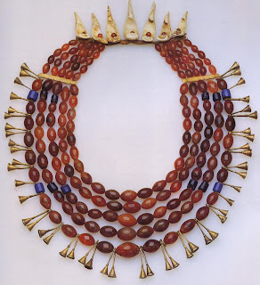 A chief of the Ao tribe owned this impressive live-strand carnelian bead necklace with bone spacers and brass trumpets. Carnel-ian beads were currency to the Naga; therefore. this necklace, which weighed more than live pounds, had consider-able value. Naga used the lost-wax casting tech-nique to make the brass trumpets.