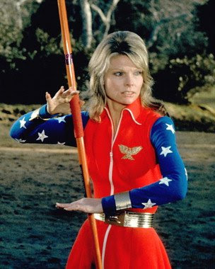 Cathy Lee Crosby as Wonder Woman with javelin