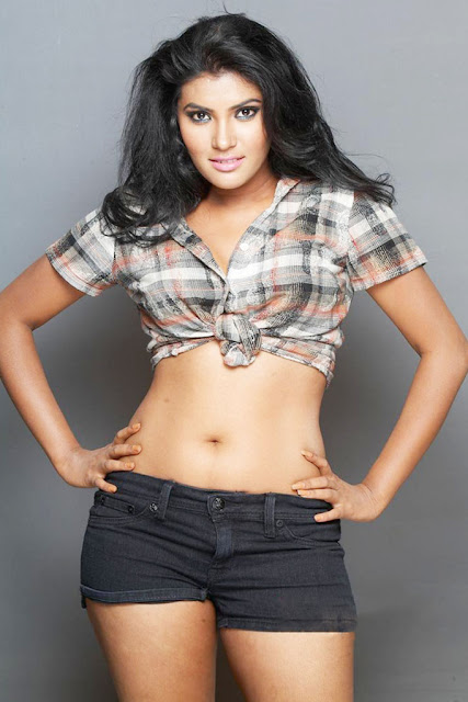 Actress Rhythamika Navel Show Photos