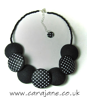 reversible lentil necklace black and white polka dots