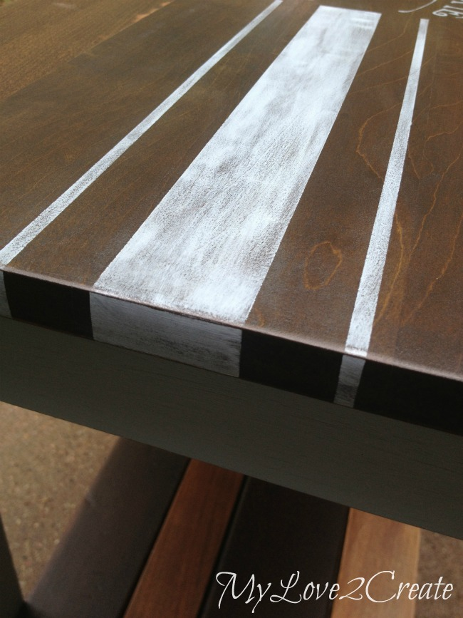 close up of grain sack stripes on top of piano bench