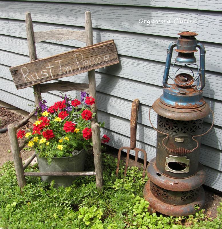 Broken Down Junk Garden Decor www.organizedclutterqueen.blogspot.com