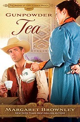 book cover of Gunpowder Tea shows a wary man holding a tea cup while a woman in a blue dress is holding a small revolver behind her back while about to pour him some tea