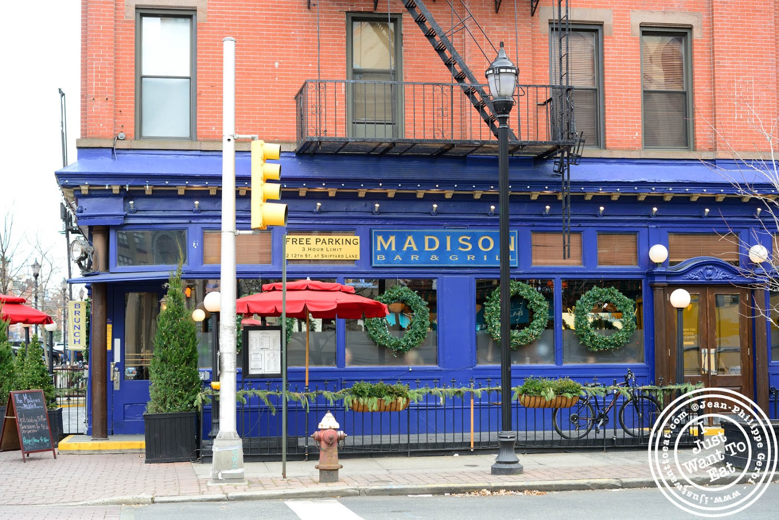 image of the entrance of the madison bar and grill in hoboken nj