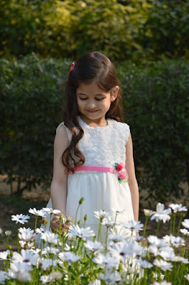 Munni enjoying with flower garden photo