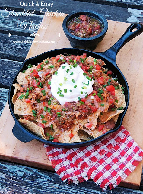 Quick and Easy Shredded Chicken Nachos from www.bobbiskozykitchen.com